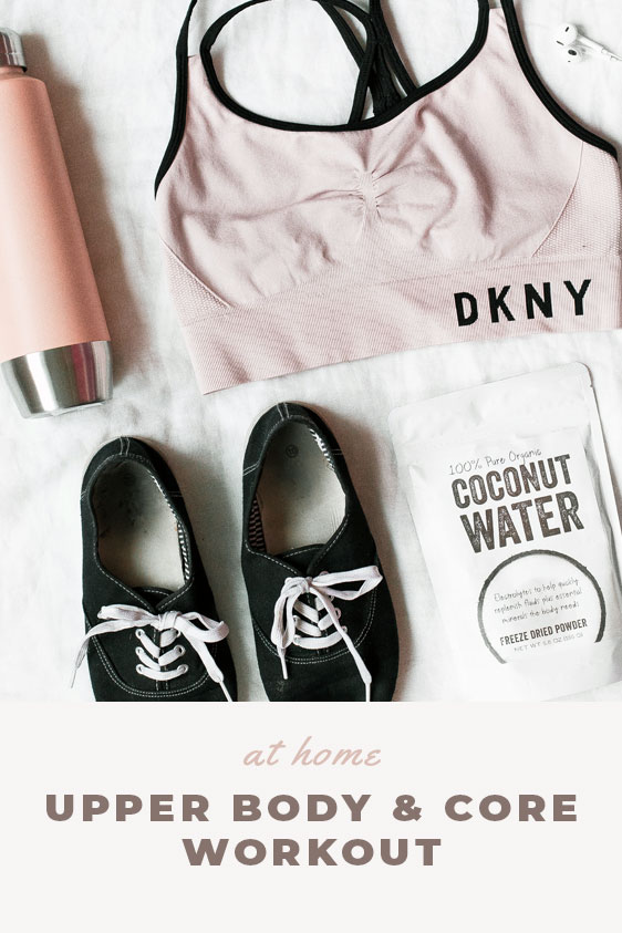 Cute workout equipment. Pink hydro flask, dkny pink sports bra, black sneakers, coconut water.