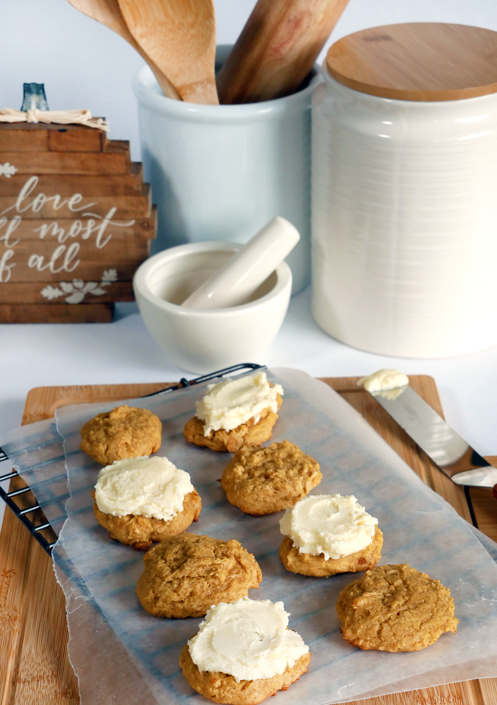 These soft-baked pumpkin cookies have the light, rich texture of butter cake & maple cinnamon cream cheese frosting for perfect fall flavor.