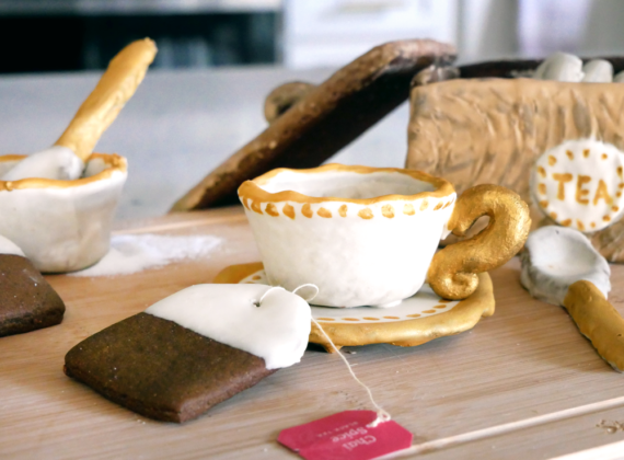 Great British Bake-Off inspired biscuit week challenge of building with cookies; a cookie tea set, teacups, and teabags made of no-spread sturdy chai gingerbread cookies