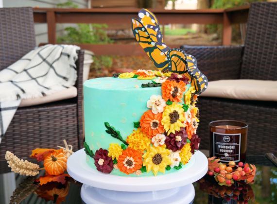 Cinnamon Apple Cake with Apple Pie Filling, Maple Simple Syrup, and Vanilla Bean Buttercream. Decorated with buttercream fall flowers and fondant monarch butterflies taking flight.
