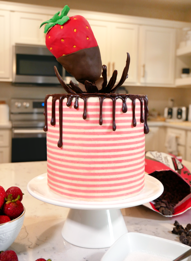 Gravity-defying chocolate-covered strawberries cake with a striped buttercream fondant.
