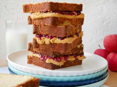 Cake made out of pound cake, peanut butter buttercream, jelly, and peanuts, but it looks like a stack of peanut butter and jelly sandwiches.