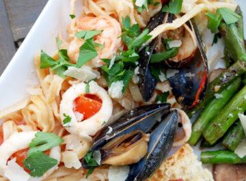 Linguine Allo Scoglio - Italian Seafood Pasta, featuring calamari, shrimp, mussels, parsley, tomatoes, and white wine