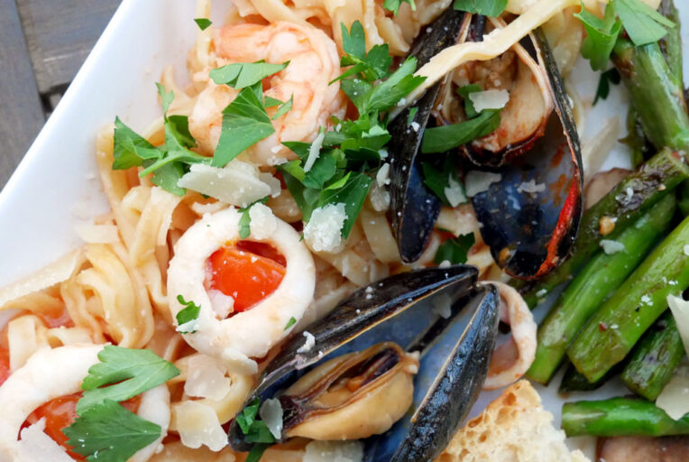 Linguine Allo Scoglio - Italian Seafood Pasta, featuring calamari, shrimp, mussels, parsley, tomatoes, and white wine