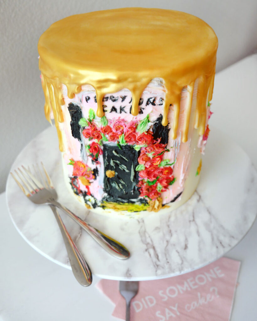 Triple Chocolate Cake Decorated to look like Peggy Porschen Cafe Front with Palette Knife Painted Flowers and a Bicycle