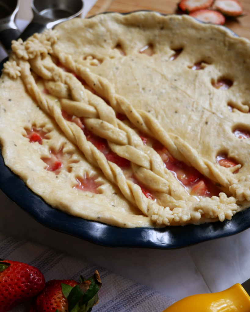 Strawberry Custard Pie with Homemade Basil Pie Crust - decorated with pie crust braids, pie crust flowers, and Pi cut out.