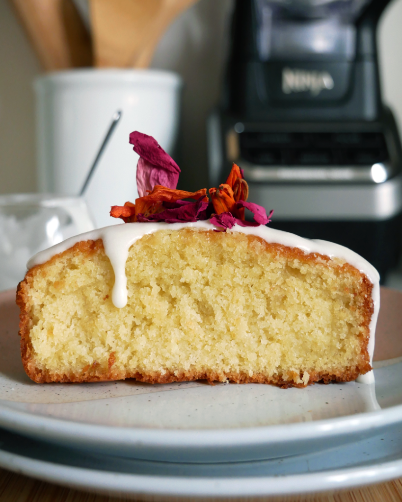 Glazed pound cake with edible flowers on top - featuring lemon glaze, classic vanilla glaze, rose glaze