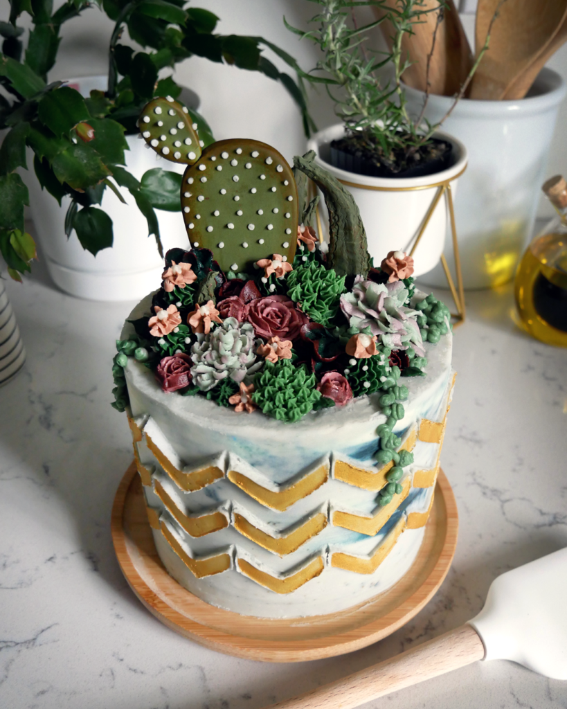 buttercream succulent flower cake with gold chevron stenciling cakebuttercream succulent flower cake with gold chevron stenciling cake