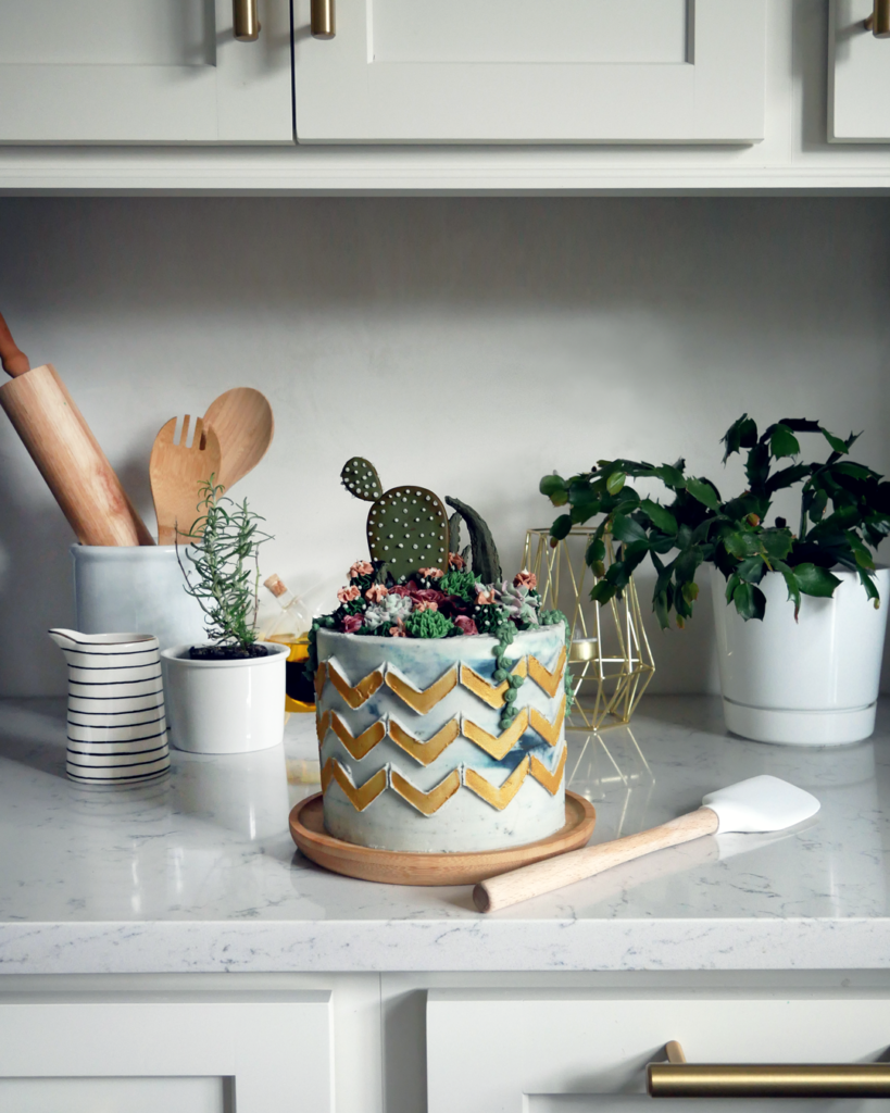 buttercream succulent flower cake with gold chevron stenciling cake