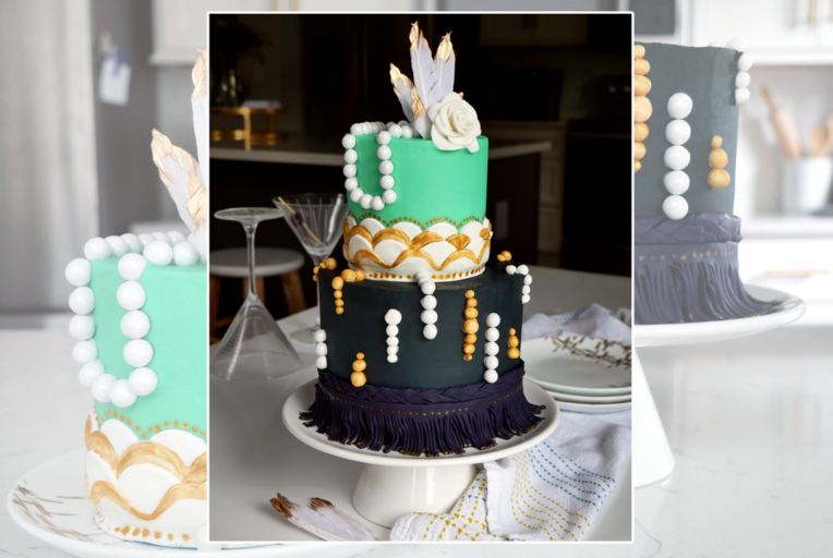 Roaring '20s cake, Great Gatsby themed cake, two tier blue and gold cake with scalloped edges, pearls, fringe, and gold with a fondant flower.
