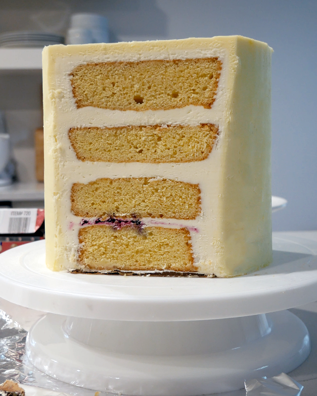 cake with slice cut to prep for sideways cake top forward style