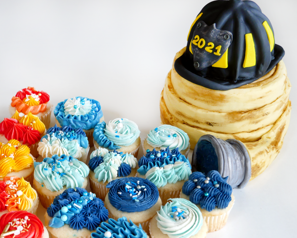 fire fighter's helmet made of cake and fire fighter's hose made of cake with fire and water cupcakes